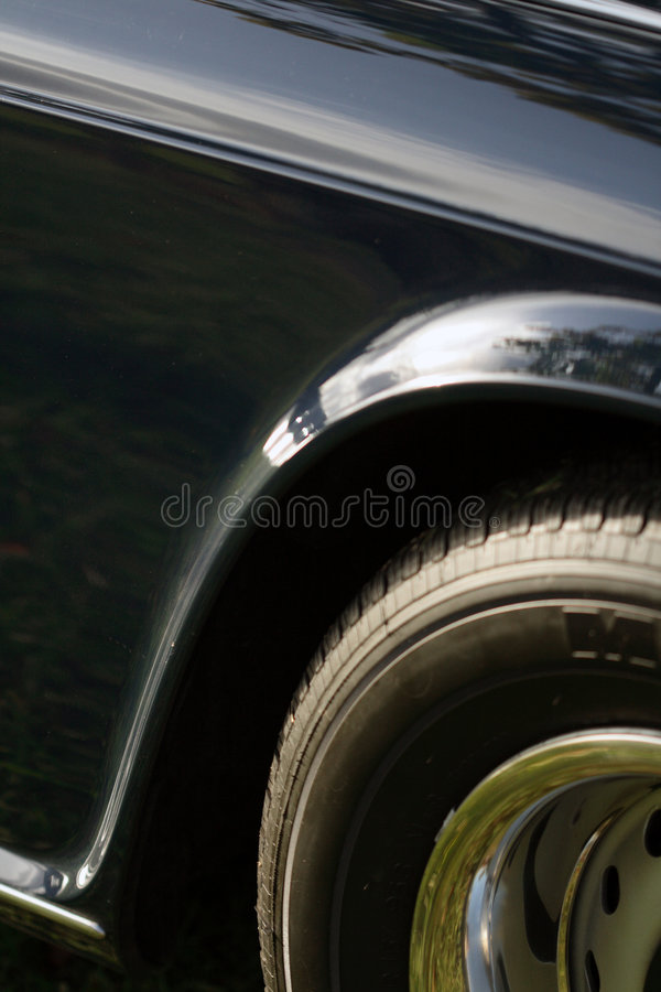 Classic British car quarter panel and tire royalty free stock photos