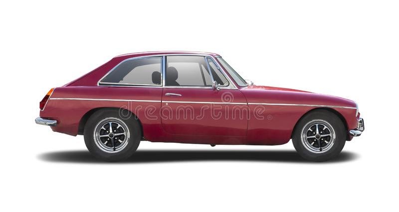 Classic British car MG MGB side view isolated on white. Classic British sport hatchback red car side view isolated on white royalty free stock photo