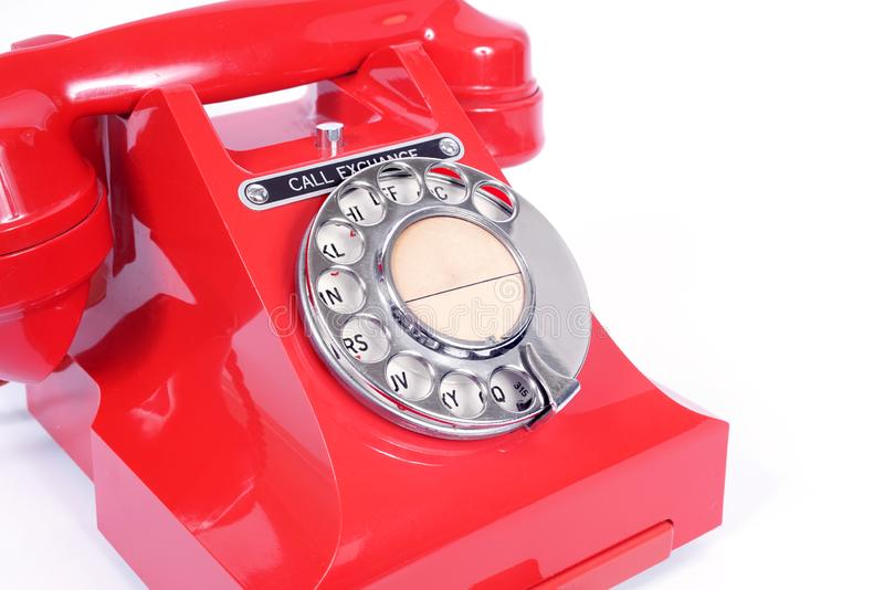 1950s Vintage Rotary Dial Red Telephone. Classic British vintage rotary dial red telephone  from the 1950s with call exchange button royalty free stock photo