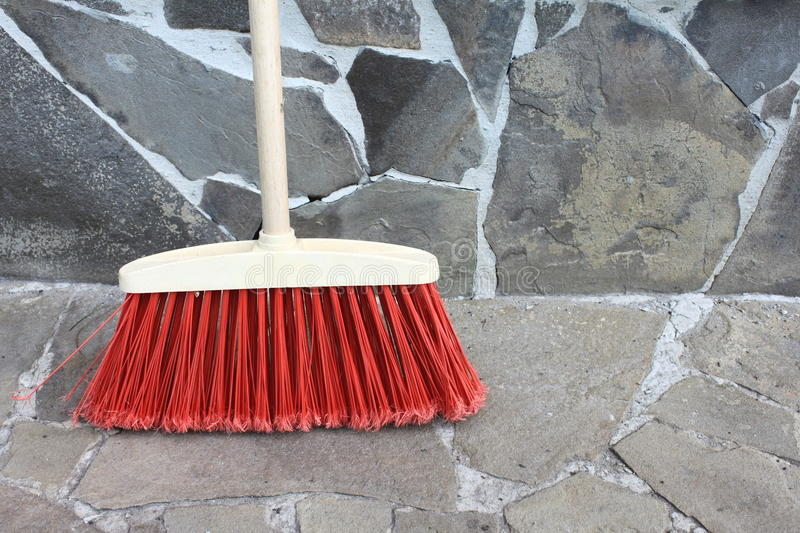 Classic broom closeup on a stone background. Classic broom close up on a stone background stock photos