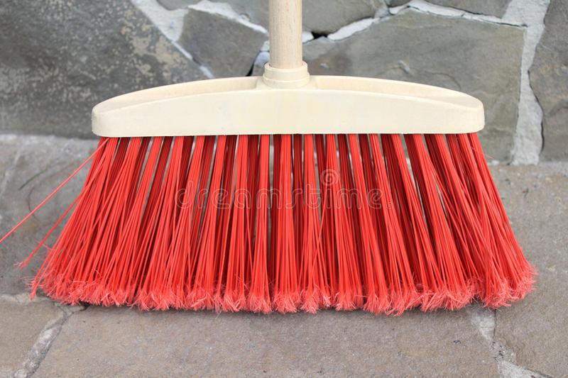 Classic broom closeup on a stone background. Classic broom close up on a stone background stock images