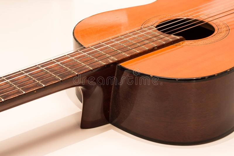 Classic acoustic guitar on white background view stock image