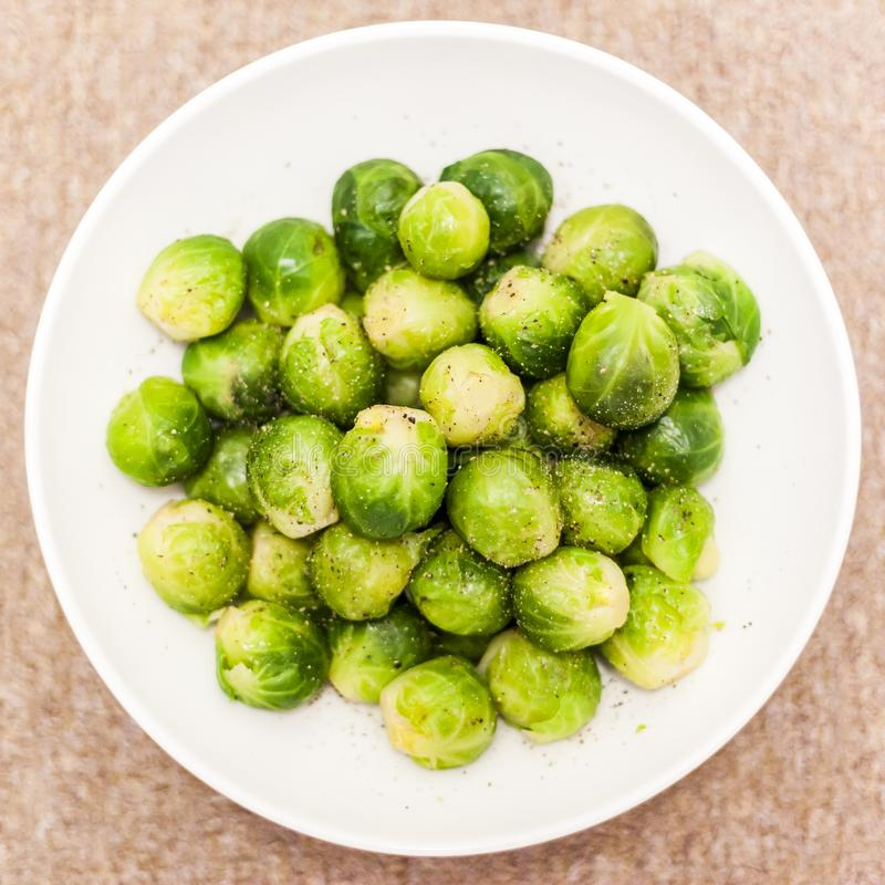 Classic brussel sprouts garnish for roast dinner healthy choice. Cooked in fresh vegetables stock and seasoned with olive oil salt and pepper and melted butter royalty free stock photos