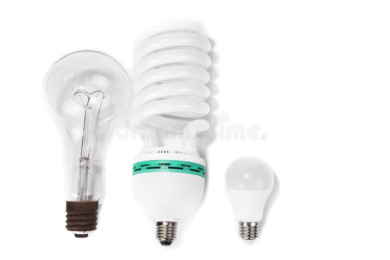 Classic bulb versus compact fluorescent versus new led bulbs. royalty free stock photos