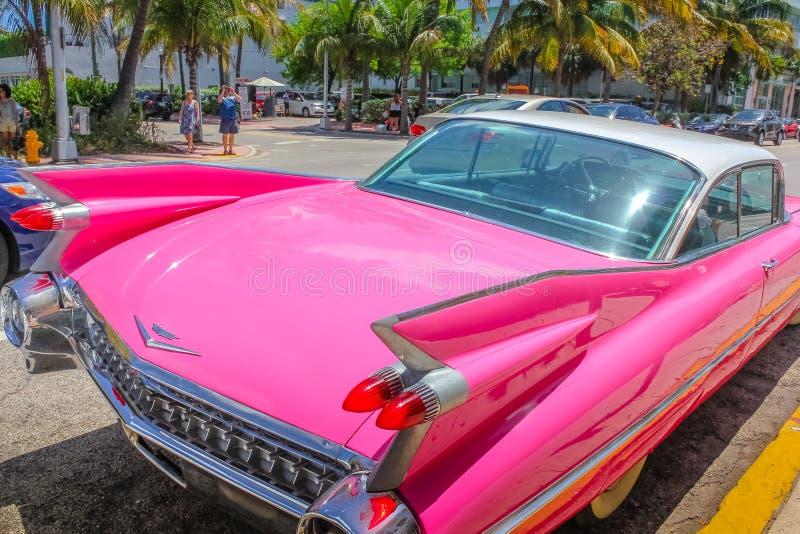 Classic Cadillac Eldorado. Miami, Florida, United States - April 8, 2012: from behind of the luxurious vintage pink Cadillac Eldorado on a street near Ocean stock photography
