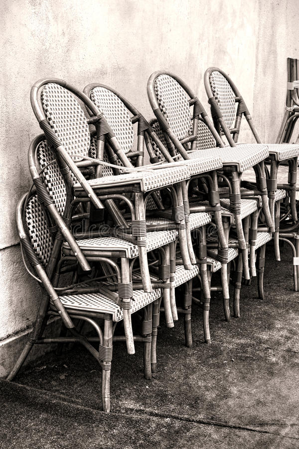 Free Classic Cafe Wicker Chairs Stacked Against A Wall Stock Photo - 34840200