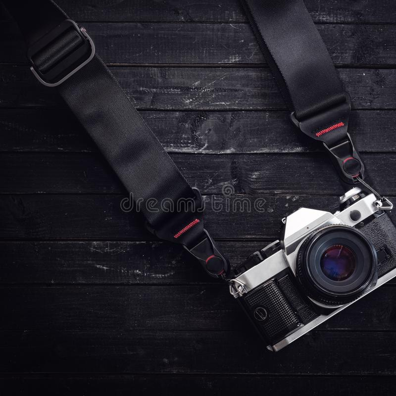 Classic camera on film with a strap stock photos