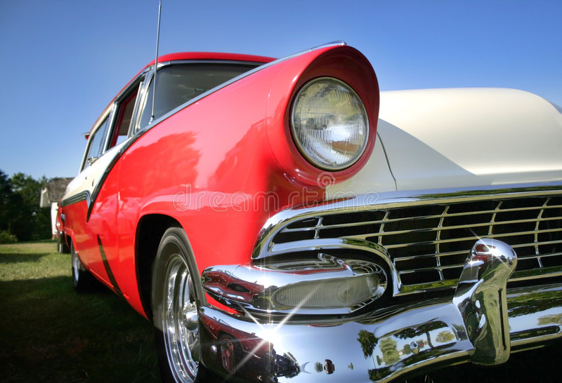 Classic Car. Sparkling Red and tan colored classic car stock photography