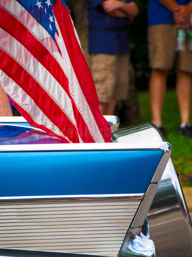 Classic Car with American Flag. Detail of a classic car with an American flag attached driving in a Fourth of July Parade royalty free stock image