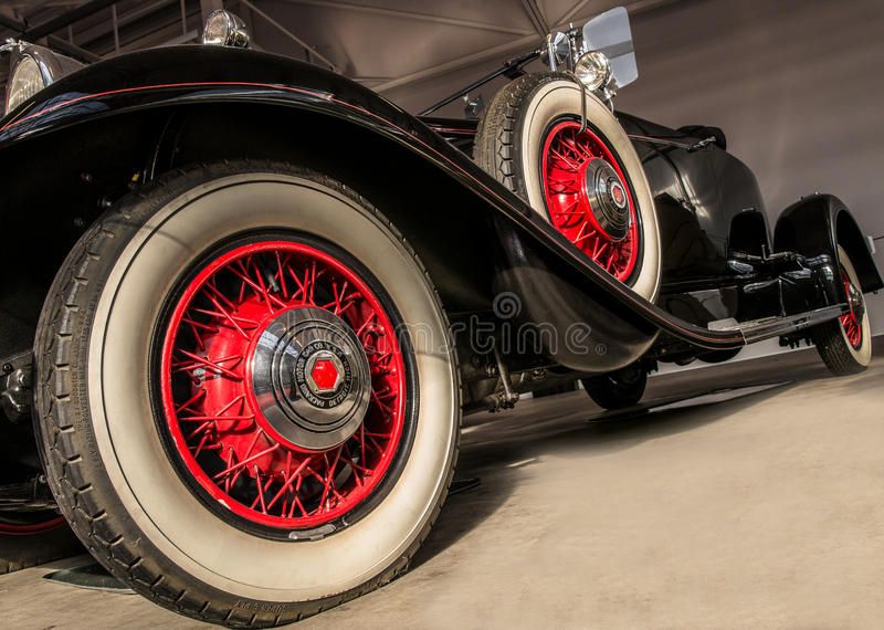 Classic american car. Classic car in black with red spiked wheels and white tires royalty free stock photos