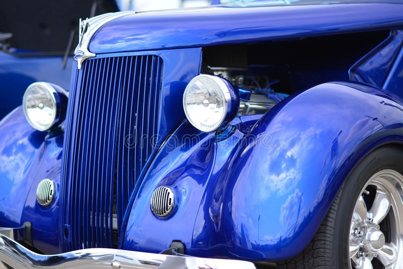 Classic Car Blue Roadster Hotrod. Blue Convertible Classic Car Roadster Hotrod reflecting clouds stock image