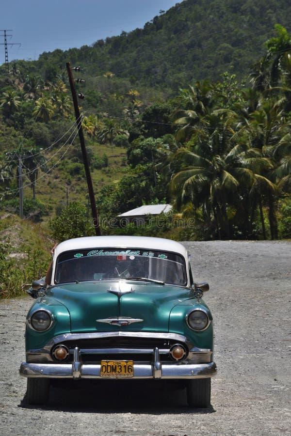 Classic car on caribbean highway royalty free stock photos