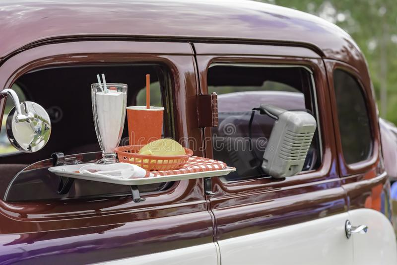 Classic car at drive in movie theater royalty free stock images