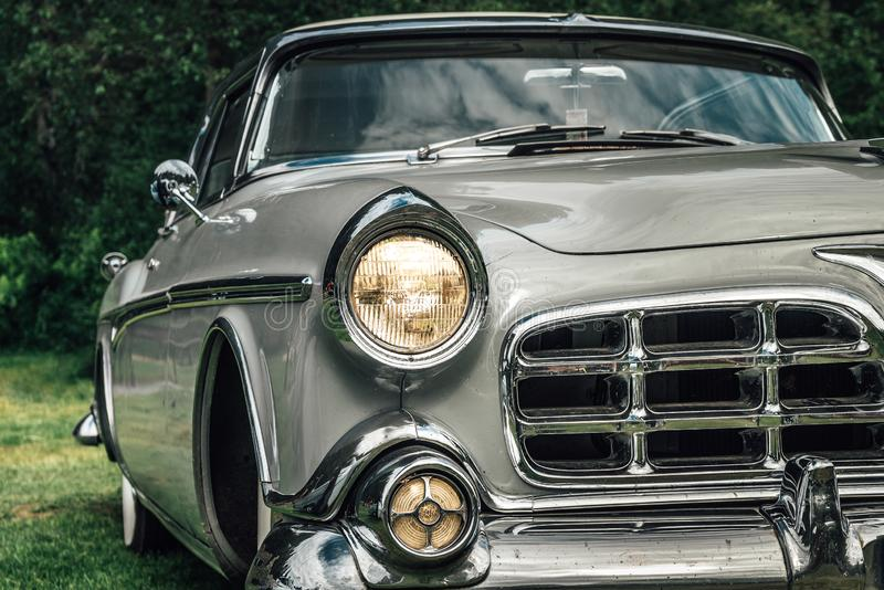 Classic car from the early fifties with large chromed grille stock photo