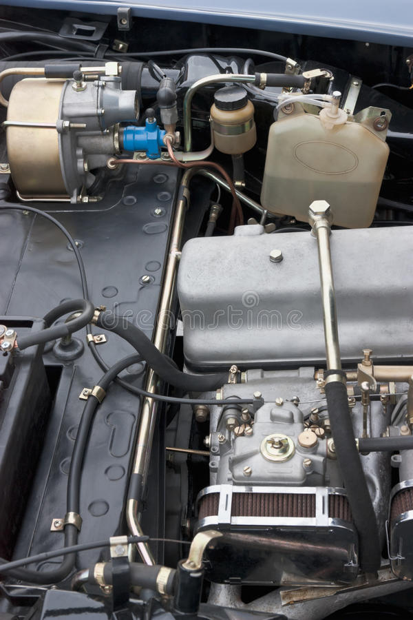 Classic car engine. Engine of an old classic car stock photos