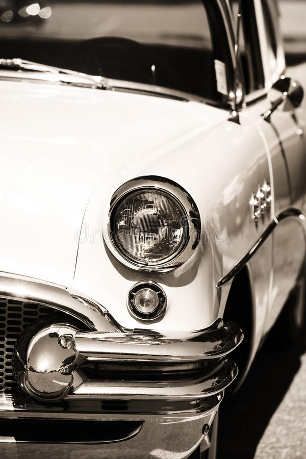 Classic car front end. Front end of classic car in sepia color stock photography