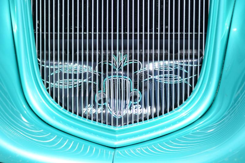 Classic Car Green Grill Roadster Hotrod. Green Grill with reflections on a Roadster Hotrod royalty free stock photo