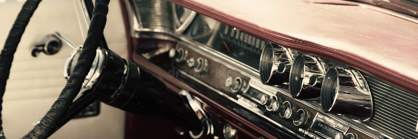 Classic car interior. Dashboard close-up stock photos