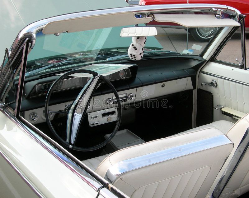 Classic car interior with dice stock image