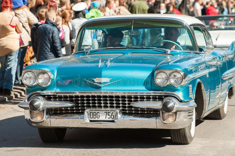 Classic car parade on May Day celebrates spring in Sweden. Norrkoping, Sweden - May 1, 2013: Cadillac Sedan De Ville 1958 at the classic car parade celebrating royalty free stock images