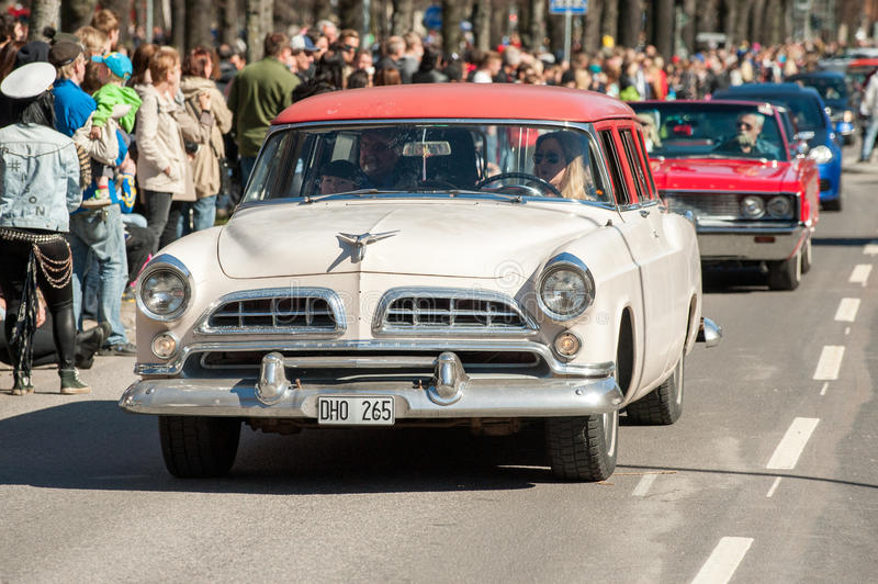 Classic car parade on May Day celebrates spring in Sweden. Norrkoping, Sweden - May 1, 2013: Chrysler Town & Country Wagon 1955 at the classic car parade royalty free stock photo