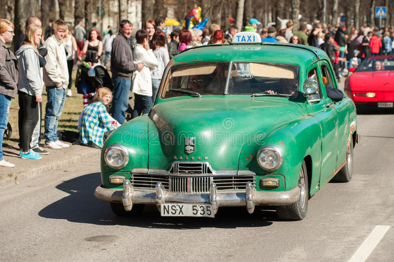Classic car parade on May Day celebrates spring in Sweden. Norrkoping, Sweden - May 1, 2013: Kaiser Special Sedan 1947 at the classic car parade celebrating stock image
