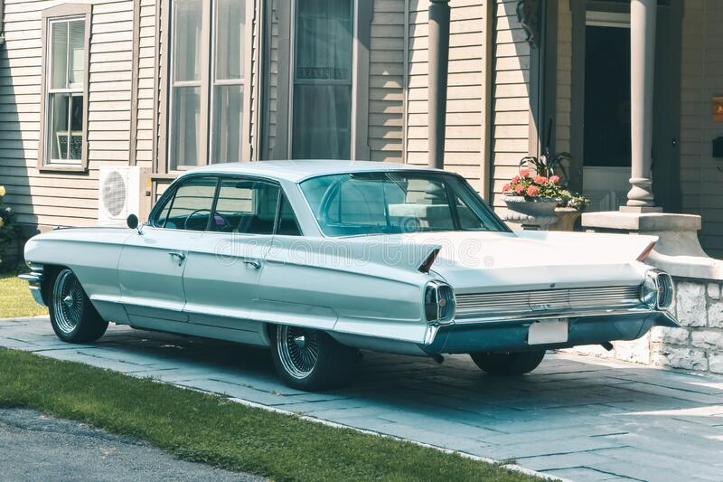 Classic car parked outside of the house. Pastel vintage colors. Canada.  stock image