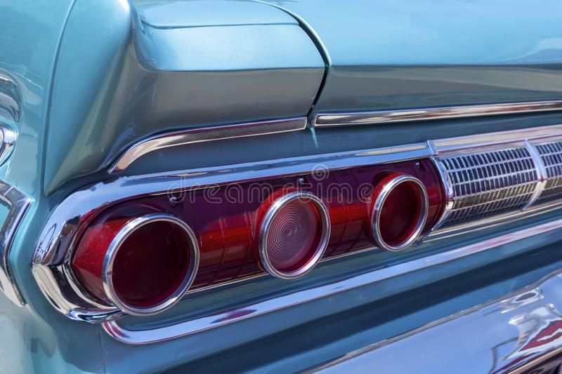 Classic car tail light detail. Detail of a classic car tail light stock images