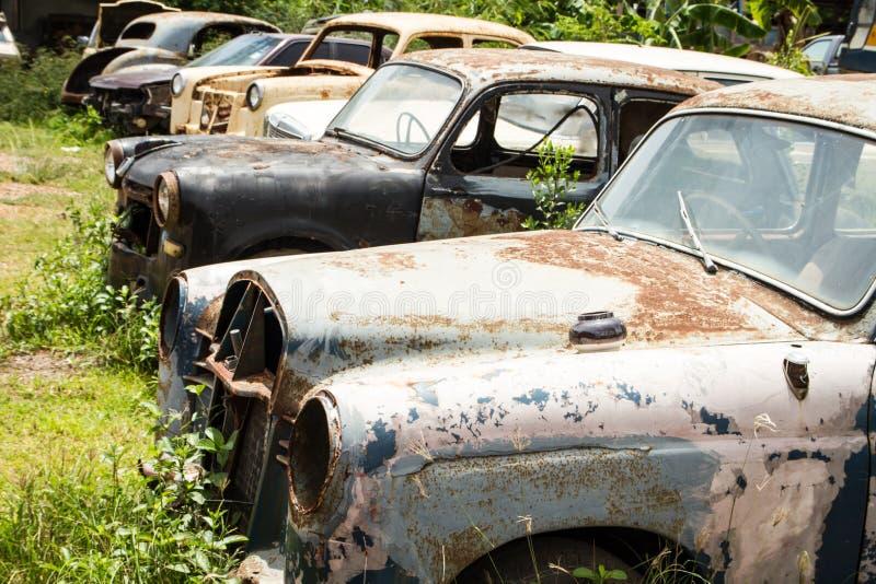 Classic car wreck at a junkyard.  stock photos