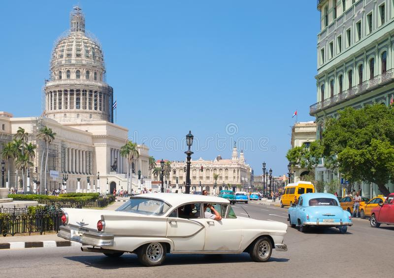 Classic cars near the Capitol building, a symbol of Havana stock photo