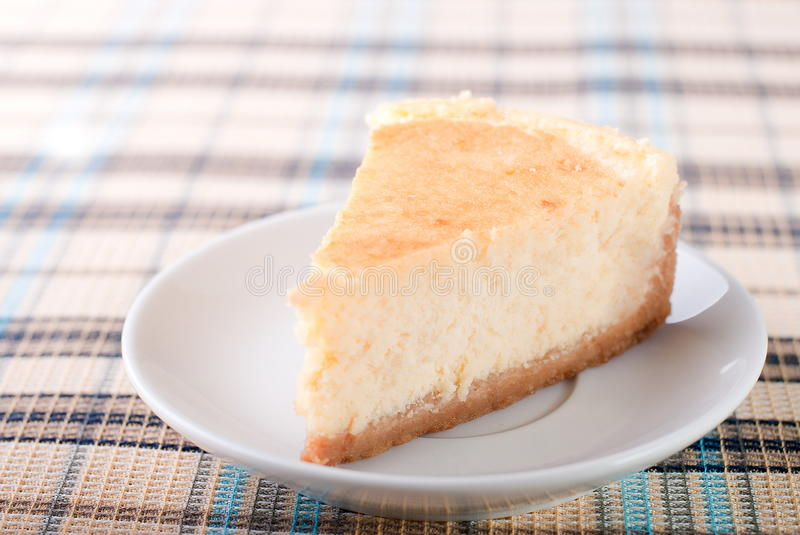 Classic cheesecake on a plate royalty free stock image
