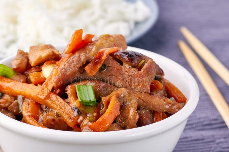 Classic Chinese sweet and sour pork in white bowl stock images