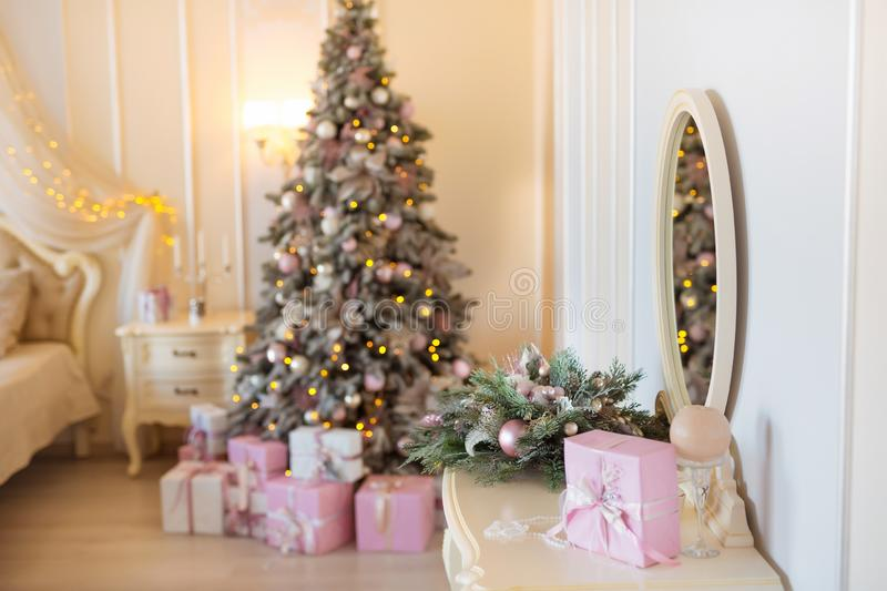 Classic Christmas decorated interior room with New year tree. Modern luxury design apartment bedroom with bed. Christmas. Eve at home stock images