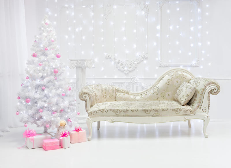 Classic Christmas light interior in white and pink tones with a couch royalty free stock photography
