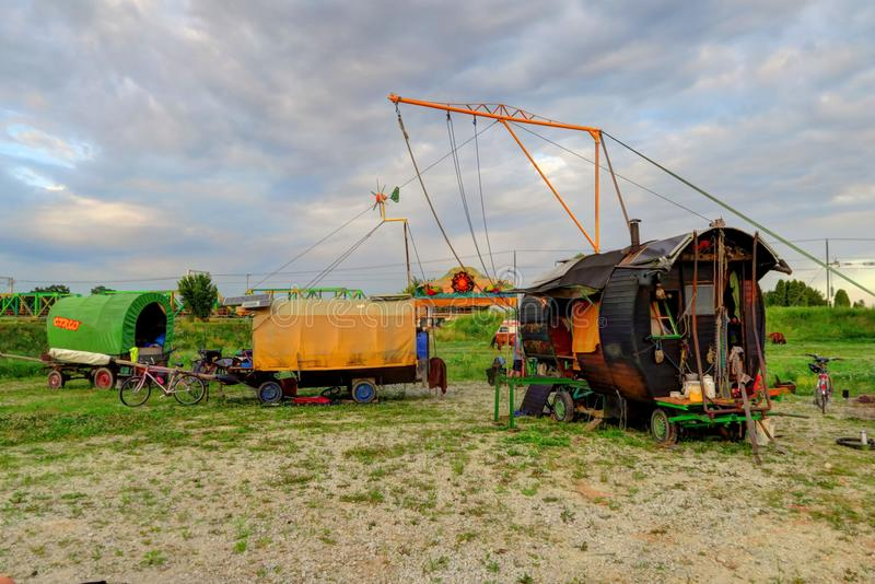 Classic circus gypsy caravan and aerial rig. Three horse-drawn wagons and an aerial rig are set up for a circus performance royalty free stock photo