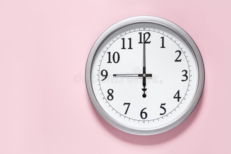 Classic clock on the wall stock images