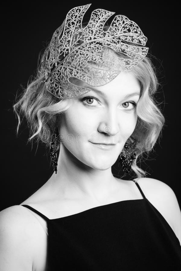 Portrait of blonde woman with leaf head accessory, BW shot stock photos
