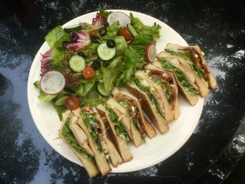 Classic Club Sandwich with fresh salad top royalty free stock images