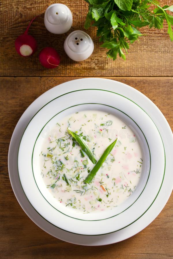 Classic cold soup Okroshka made of vegetables cucumbers, radishes and spring onions, boiled potatoes, eggs, and meat. Classic cold soup Okroshka made of stock images