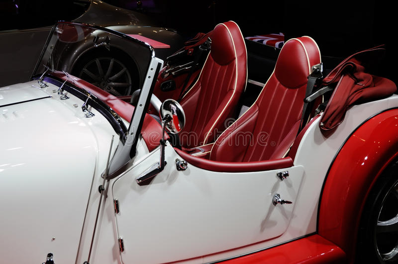 Classic convertible. A classic two-seater convertible with scarlet color stock photos