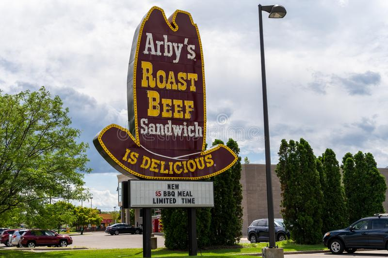 Classic cowboy hat old-school style Arby`s Roast Beef sign for the fast food restaurant. Crystal, Minnesota - July 21, 2019: Classic cowboy hat old-school style royalty free stock photos
