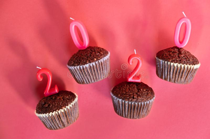 Chocolate cupcakes red background royalty free stock photos