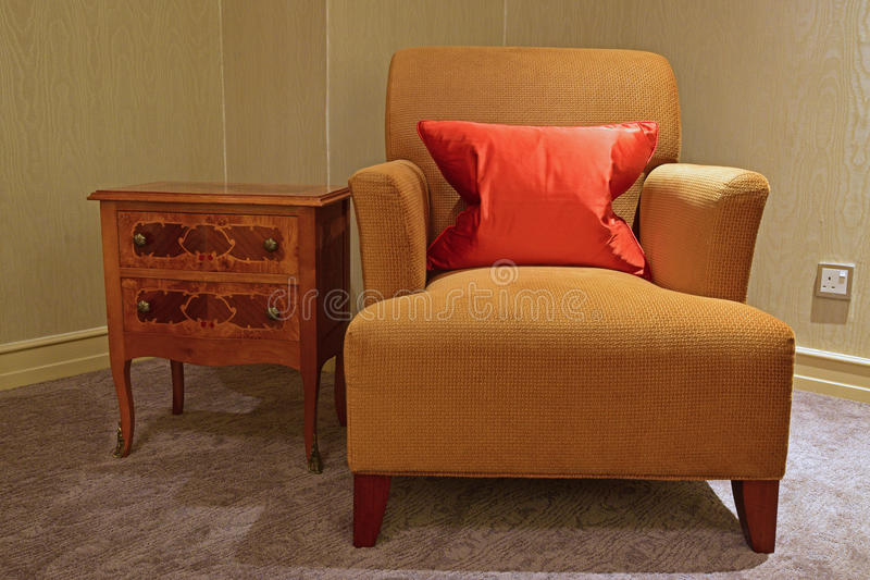 Classic design of Single Seater Sofa Chair and Side Table. This is taken on a corner of a luxury hotel suite living room with power socket at the back for royalty free stock photography
