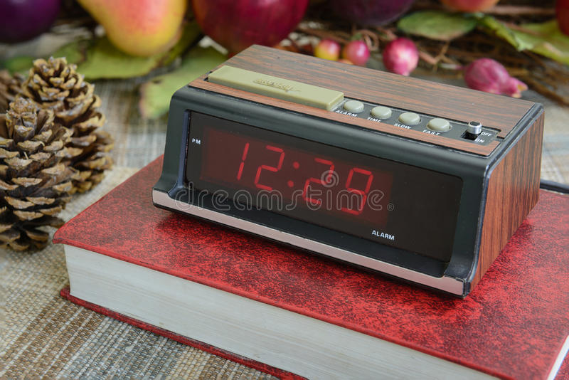 Classic digital alarm clock old condition. Old digital alarm clock, grunge and old condition, wood paint stock photography