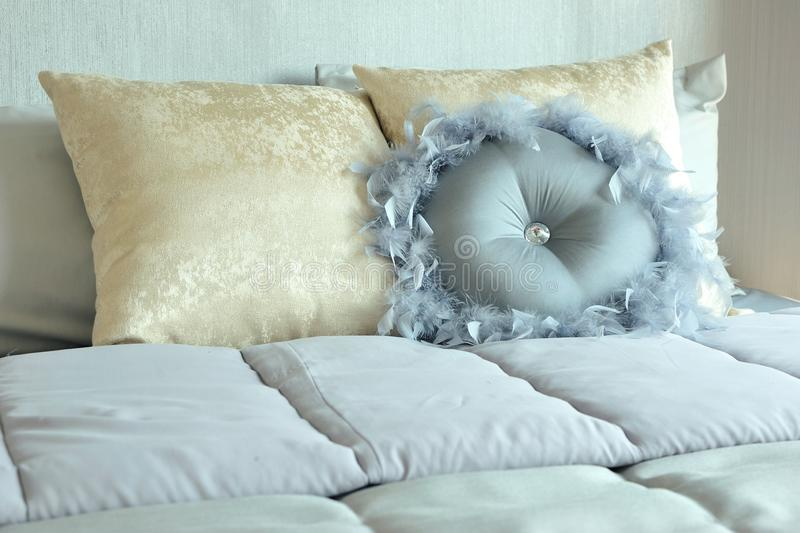 Classic and elegant pillows setting on the bed. royalty free stock images