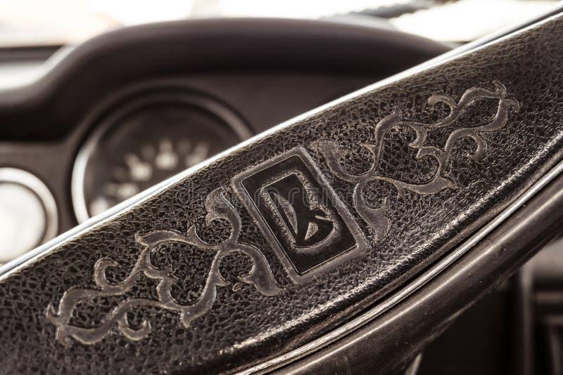 Classic emblem of the Lada car on the retro steering wheel of a Soviet car. Belgorod, Russia - July 25, 2018: Classic emblem of the Lada car on the retro royalty free stock image