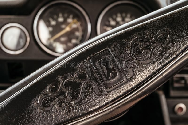 Classic emblem of the Lada car on the retro steering wheel of a Soviet car. Belgorod, Russia - July 25, 2018: Classic emblem of the Lada car on the retro royalty free stock photos