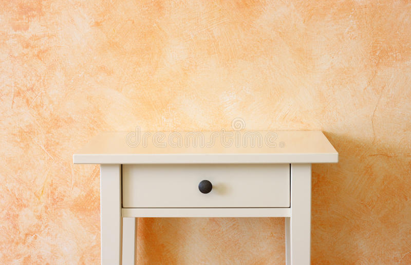 Classic empty drawer near terracotta textured wall. room for copy space. Classic empty drawer near terracotta textured wall royalty free stock photo