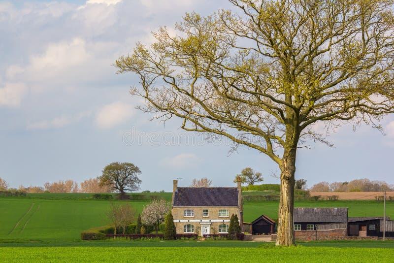 Classic English country cottage farmhouse. Idyllic countryside h stock photos