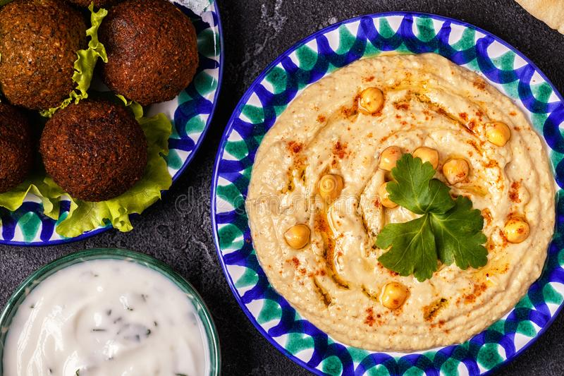 Classic falafel and hummus on the plates. stock photography